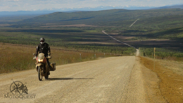 Lone rider on a seemingly endless road