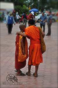 Monks walk the streets of Luang Prabang
