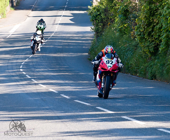 Riders battle for position during the TT.