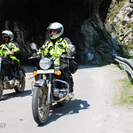 Kagan riding India's Spiti River Valley with MotoQuest Guide Anu