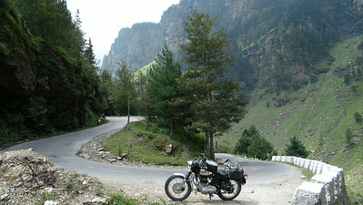 Royal Enfield surrounded by green hills